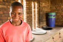This man is an extremely shy cook at a school in southern Uganda, photographed here in his new biogas-powered kitchen.