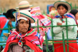 This lady, dressed in traditional Aymara clothing, doesn't look too pleased with how the celebrations are going at a local festival in Apolobamba. Copyright Tom Broadhurst.