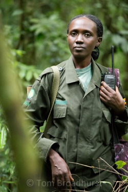 Prossy, a Uganda Wildlife Authority ranger and guide, seen here in Kibale National Park. Rangers like her are vital for protecting and educating about wild places and the animals that live there - such as chimpanzees at Kibale. Copyright Tom Broadhurst.