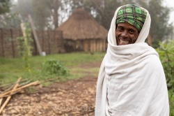 Fenta is one of the guards at Limalimo lodge in Ethiopia's Simien mountains. He wears traditional Ethiopian robes to keep him warn during the cold nights. Copyright Tom Broadhurst.