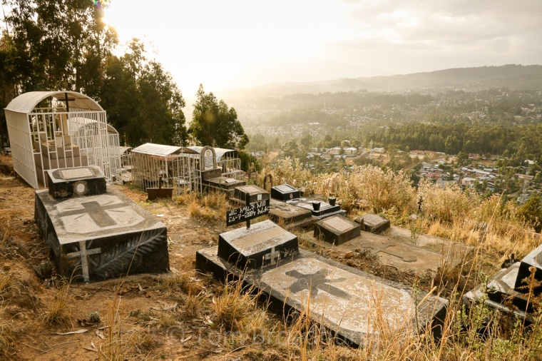 The dead-centre of town! Graveyard overlooking Addis Ababa, Ethiopia. Copyright Tom Broadhurst.