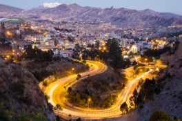 Mount Illimani overlooks the lights of La Paz shortly after sunset. Taken from the Costanera, the busy road that links the city centre with affluent Zona Sur (seen here). Copyright Tom Broadhurst.