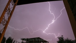 Lightning strike framed by the balcony at my (former) house in Addis Ababa. Copyright Tom Broadhurst.