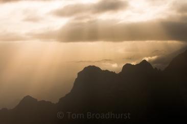 The sun creeps through the clouds over Ethiopia's Simien Mountains during rainy season. Copyright Tom Broadhurst.